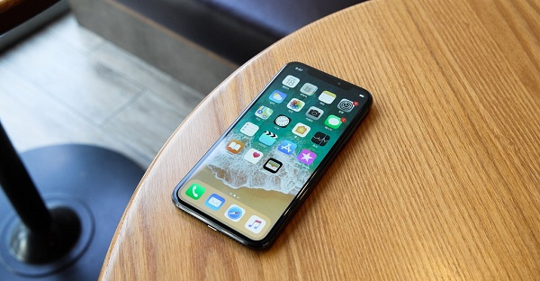 An iPhone X on a table
