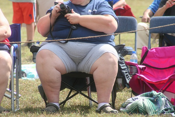 Obese lady sitting on a chair