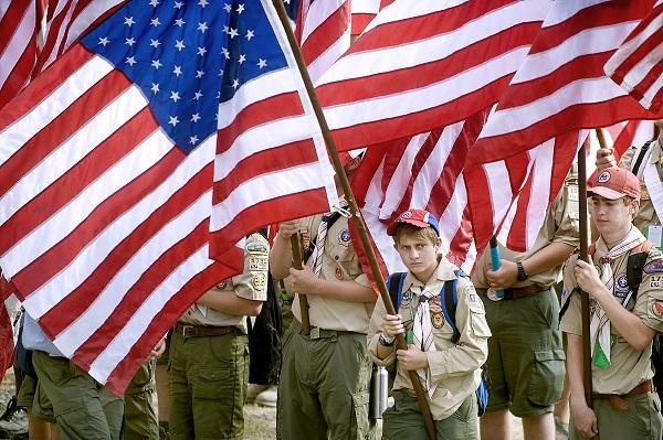 Boy scout carrying U.S. flag