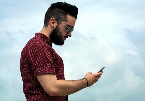 Stressed-out hipster texting
