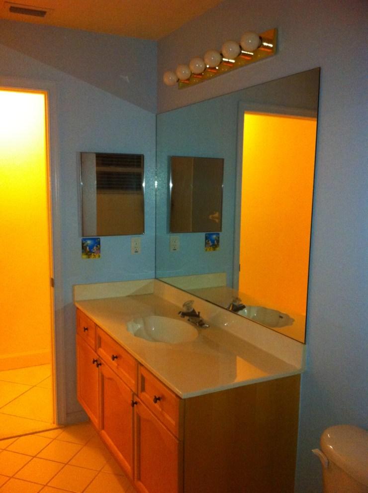 Before pic of builder's grade bathroom
