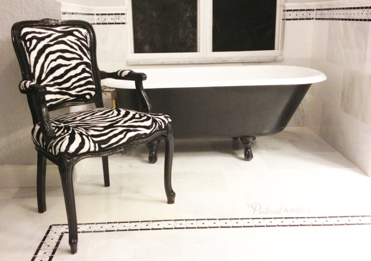 clawfoot bathtub and chair