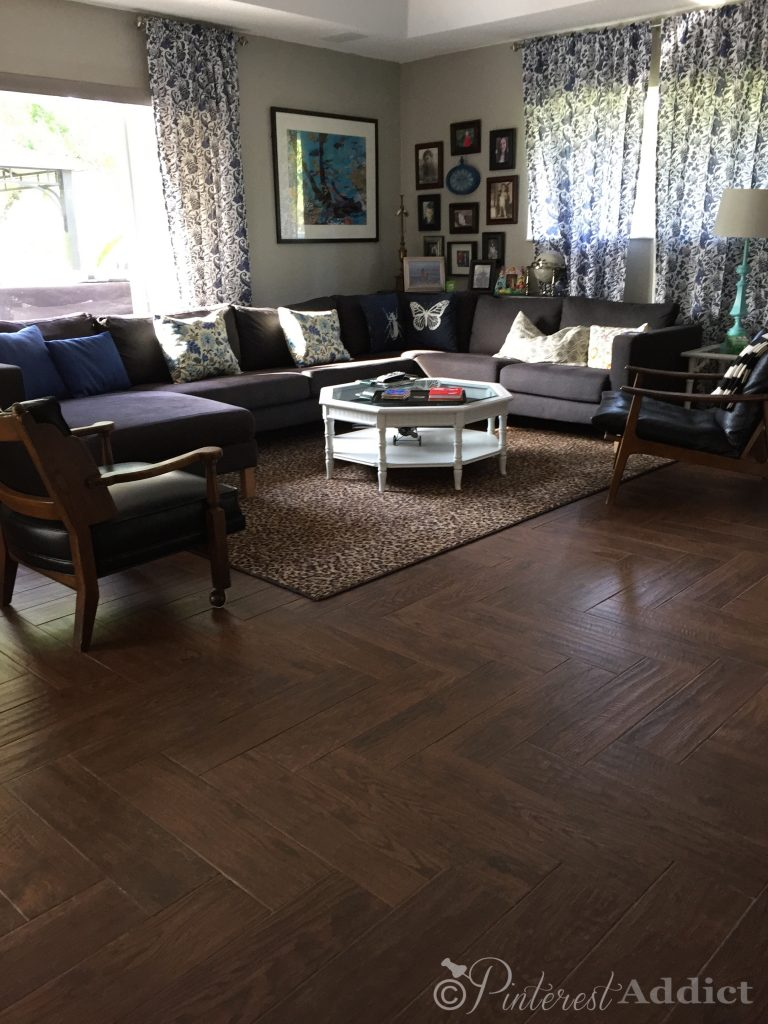family room herringbone wood look tile floor