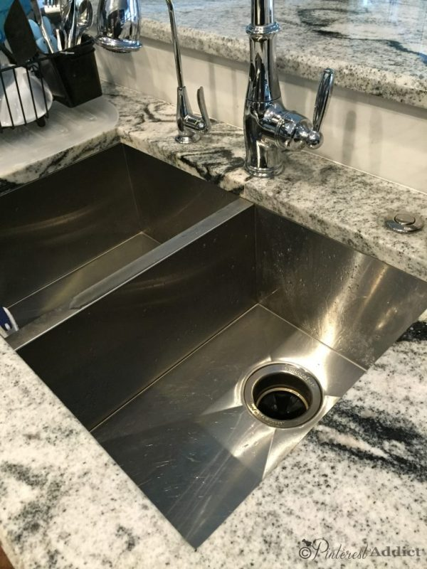 counter button for garbage disposal activation
