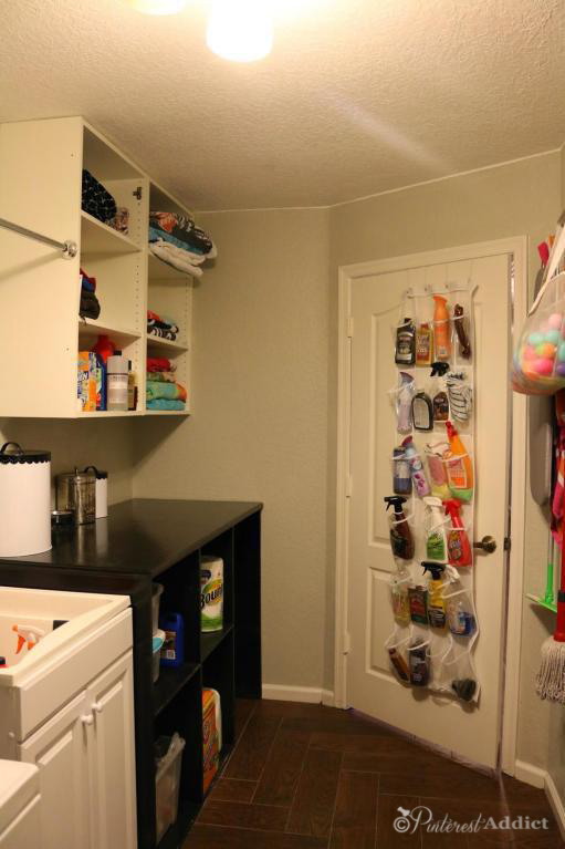 Moving and Adopting Post. - Laundry room - with the folding table we built - cleaning supply storage