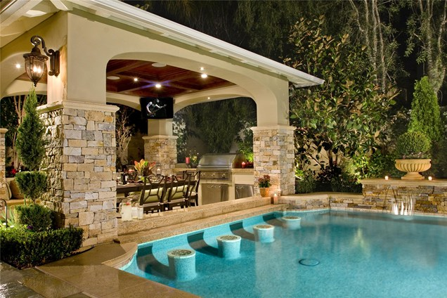 Swim up bar with stools. Love the outdoor living area too