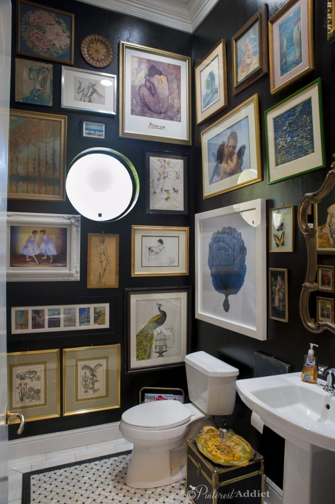dark bathroom with gallery wall
