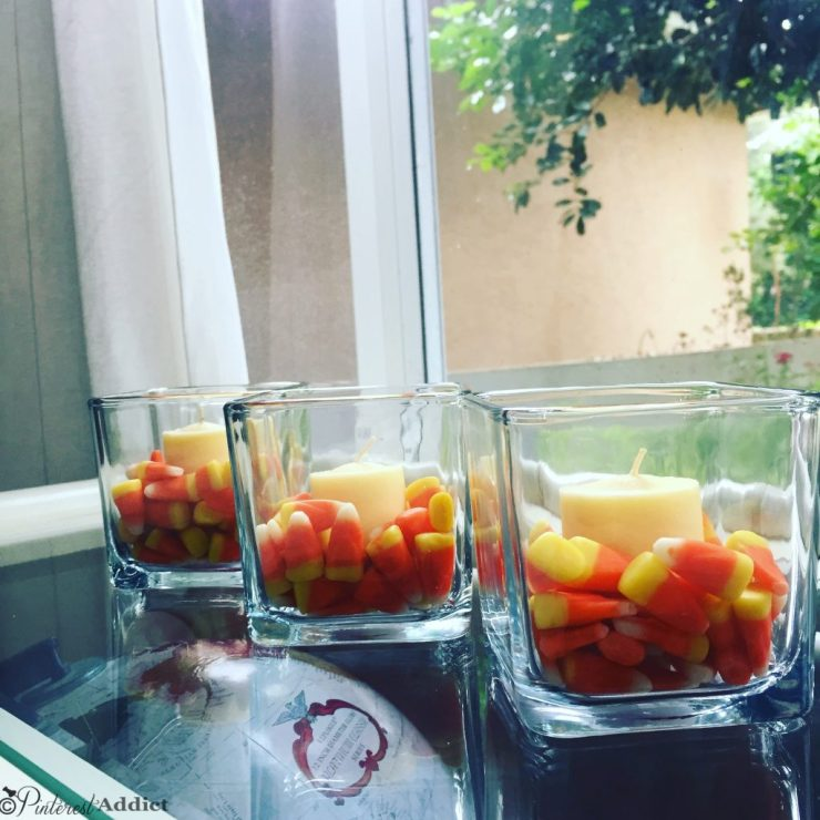 Candy corn and tea lights with dollar store cube vases