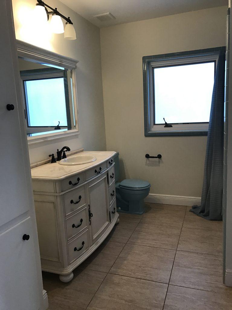 Blue bathroom toilet and tub