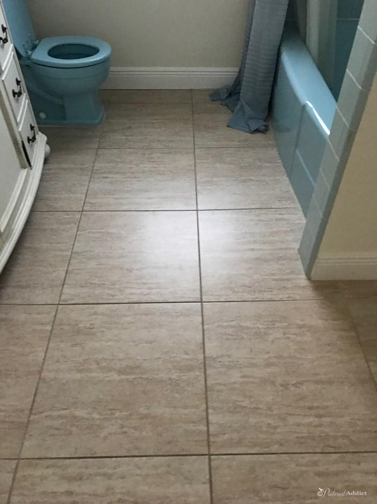 bathroom floor tile blue toilet and blue tub