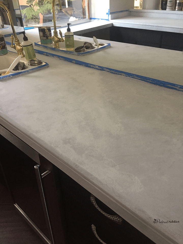 white chalk paint layer of faux marble countertops