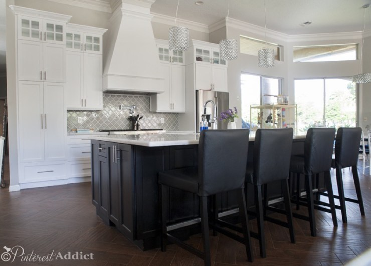 white kitchen black cabinets quartzite counters