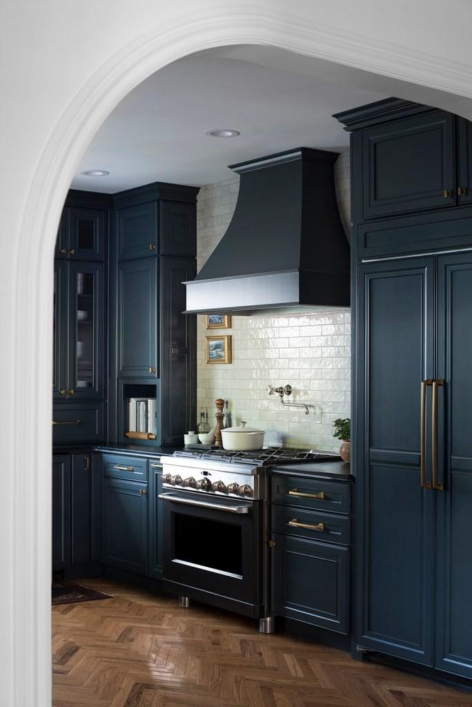 Room For Tuesday - kitchen - herringbone floors, dark blue cabinets, pot filler