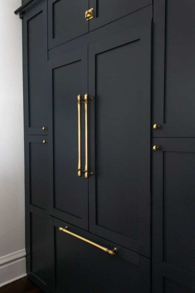 Beginning in the middle - black cabinets, brass hardware, latches
