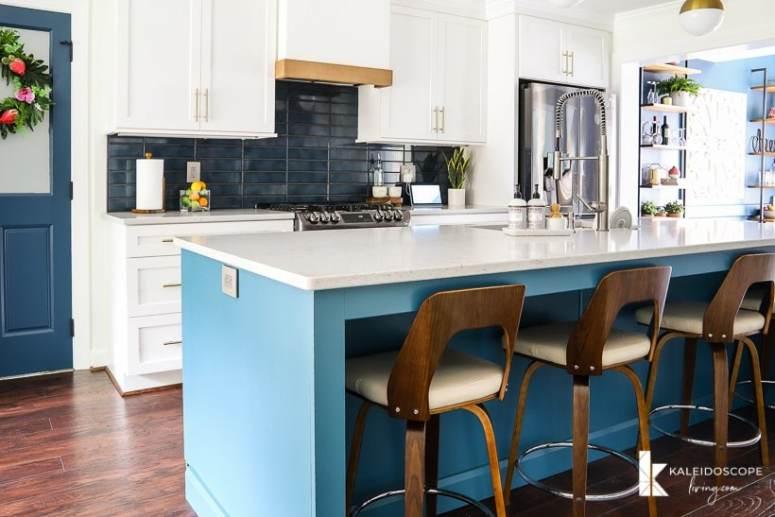 Kaleidoscope Living - kitchen - dark blue backsplash, wood bar stools