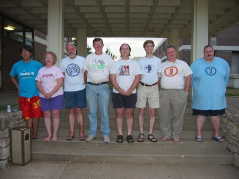KansasFest attendees wearing shirts representing the event's different years