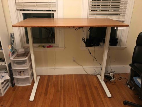 Uplift's Bamboo Stand Up Desk, raised