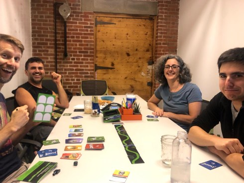 Four adults playing a card game