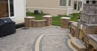 Brick Paver Patio with Free Standing Block Wall and ...