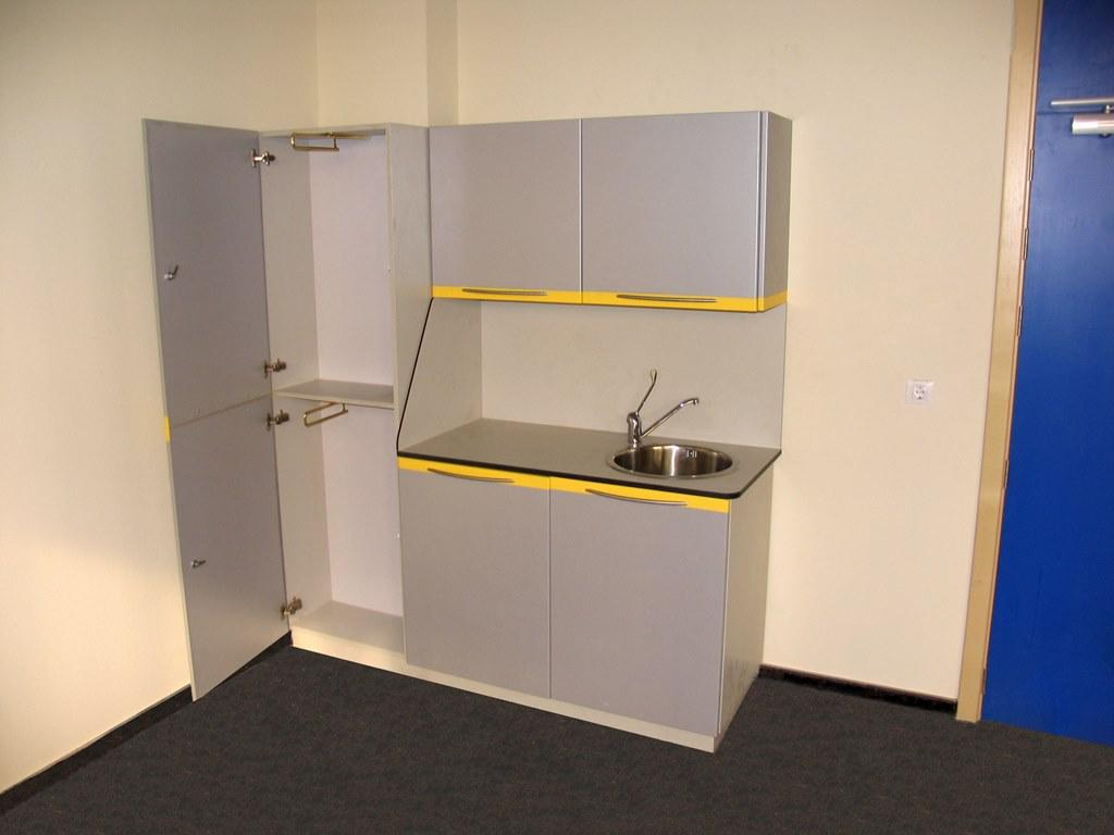 Muebles de consulta con encimera en resina fenolica