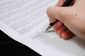 a person signing a contract