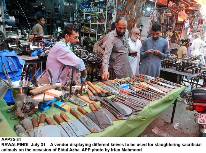 RAWALPINDI: July 31 – A vendor displaying different knives to be used for slaughtering sacrificial animals on the occasion of Eidul Azha. APP photo by Irfan Mahmood