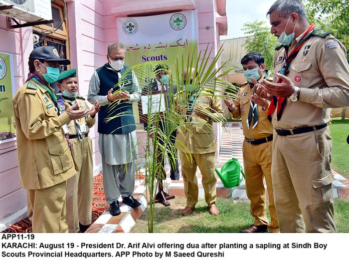 KARACHI: August 19 - President Dr. Arif Alvi offering dua after planting a sapling at Sindh Boy Scouts Provincial Headquarters. APP Photo by M Saeed Qureshi