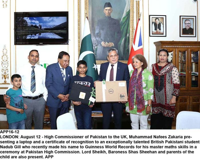 LONDON: August 12 - High Commissioner of Pakistan to the UK, Muhammad Nafees Zakaria presenting a laptop and a certificate of recognition to an exceptionally talented British Pakistani student Nadub Gill who recently made his name to Guinness World Records for his master maths skills in a ceremony at Pakistan High Commission. Lord Sheikh, Baroness Shas Sheehan and parents of the child are also present. APP