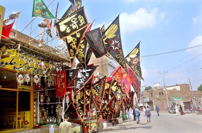 MULTAN: August 22 - Shopkeepers displays Muharram-ul-Haram processions related stuff to attract the customer near Ali Chowk. APP photo by Tanveer Bukhari