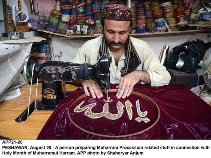 PESHAWAR: August 20 - A person preparing Muharram Procession related stuff in connection with Holy Month of Muharramul Harram. APP photo by Shaheryar Anjum