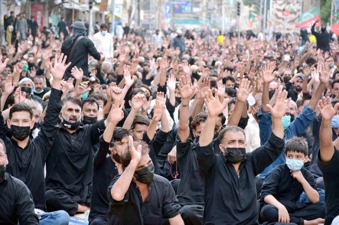 KARACHI: August 30 – A large number of mourners attending the procession of Aashura at M A Jinnah road on Youm-e-Ashura, the 10th day of Muharram-ul-Harram. Aashura marks the death anniversary of Imam Hussain ibn Ali (AS), (the grandson of Prophet Mohammad (PBUH)) a 7th century revolutionary leader who was martyred in the battle of Karbala. The day of Ashura is recognised by millions across the world to remember Imam Hussain's dignified stand for social justice. APP photo by M.Saeed Qureshi