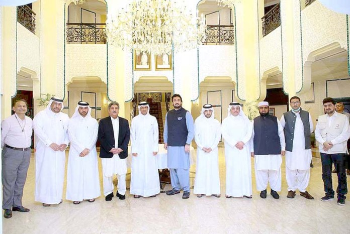 ISLAMABAD – Ambassador of State of Qatar Sheikh Saoud bin Abdulrahman Al Thani in a group photo after handed over a shipment of KN95 Masks, Medicines, Pulse Oximeters and other medical items to Minister of State for States & Frontier Regions (SAFRON) Shehryar Khan Afridi to help the Afghan refugees fight the Covid-19 pandemic. APP