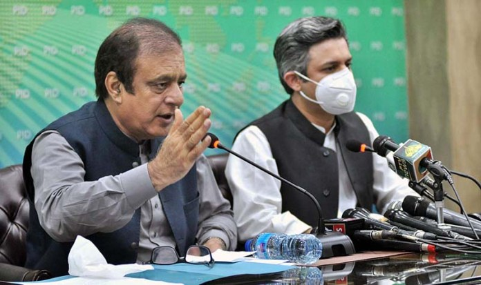 ISLAMABAD: August 24 – Federal Minister for Information and Broadcasting Senator Shibli Faraz and Federal Minister for Industries and Production Hammad Azhar addressing a joint press conference. APP photo by Irshad Sheikh