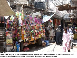 LARKANA: August 17 - A vendor displaying toys on WAPDA transformer in the Resham Gali and needs the attention of concerned authorities. APP photo by Nadeem Akhtar