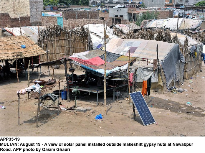 MULTAN: August 19 - A view of solar panel installed outside makeshift gypsy huts at Nawabpur Road. APP photo by Qasim Ghauri