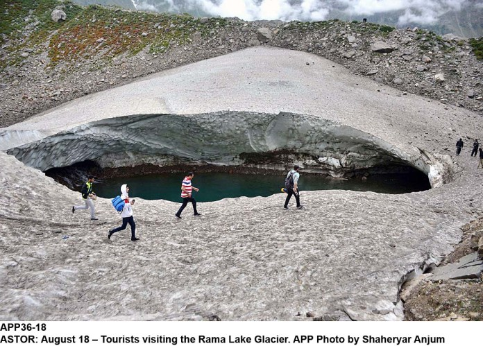 ASTOR: August 18 – Tourists visiting the Rama Lake Glacier. APP Photo by Shaheryar Anjum