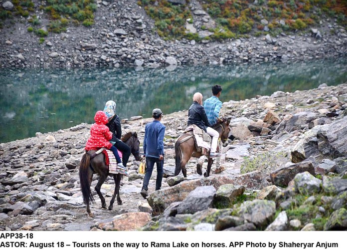 ASTOR: August 18 – Tourists on the way to Rama Lake on horses. APP Photo by Shaheryar Anjum