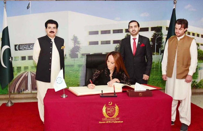 ISLAMABAD: August 24 – President of Inter-Parliamentary Union (IPU) Ms. Gabriela Cuevas Barron, recording her comments on guest book placed at Senate of Pakistan, Parliament House. APP