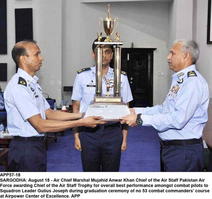 SARGODHA: August 18 - Air Chief Marshal Mujahid Anwar Khan Chief of the Air Staff Pakistan Air Force awarding Chief of the Air Staff Trophy for overall best performance amongst combat pilots to Squadron Leader Gulius Joseph during graduation ceremony of no 53 combat commanders' course at Airpower Center of Excellence. APP
