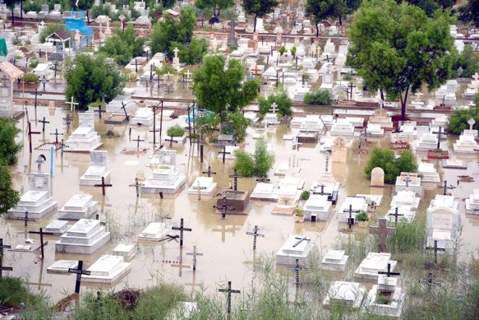 KARACHI: August 27 – Graveyard (Gora Qabrastan) submerged in water after heavy rain in Provincial Capital. APP Photo by M Saeed Qureshi