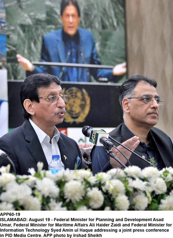 ISLAMABAD: August 19 - Federal Minister for Planning and Development Asad Umar, Federal Minister for Maritime Affairs Ali Haider Zaidi and Federal Minister for Information Technology Syed Amin ul Haque addressing a joint press conference in PID Media Centre. APP photo by Irshad Sheikh