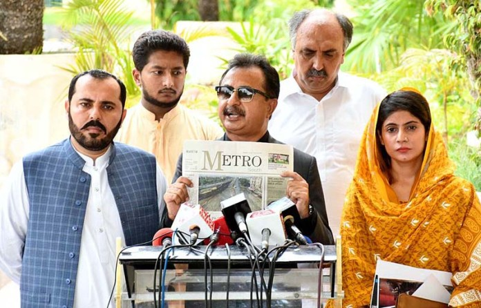 Pakistan Tehreek e Insaf (PTI) Vice President and Parliamentary Party leader in Sindh Assembly Haleem Adil Sheikh talking to media persons. APP