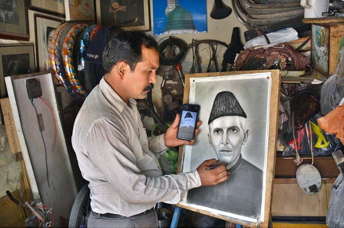 FAISALABAD: September 10 - A painter giving final touch to portrait of Quaid-e-Azam Muhammad Ali Jinnah in connection with death anniversary of Quaid-e-Azad. APP photo by Tasawar Abbas