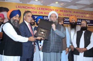 "LAHORE: September 18 - Federal Minister for Religious Affairs and Inter-faith Harmony, Peer Noor-ul-Haq Qadri launching book on ""Historical Gurdwaras in Pakistan"" during the ceremony . APP Photo by Rana Imran"