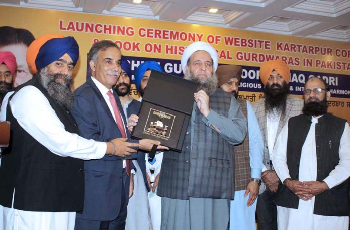 "LAHORE: September 18 - Federal Minister for Religious Affairs and Inter-faith Harmony, Peer Noor-ul-Haq Qadri launching book on ""Historical Gurdwaras in Pakistan"