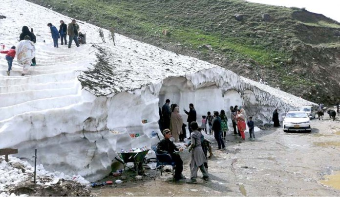NARAN: September 19 - People visiting and viewing snow avalanche at Kaghan-Naran Road as a large number of people arrives to visit the area. APP photo by Qasim Ghauri
