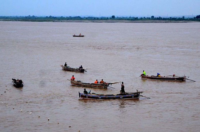HYDERABAD: September 01 – Fishermen are busy in fishing on the boats at Indus River as water level increasing of Indus River after heavy rains in the country. APP photo by Farhan Khan