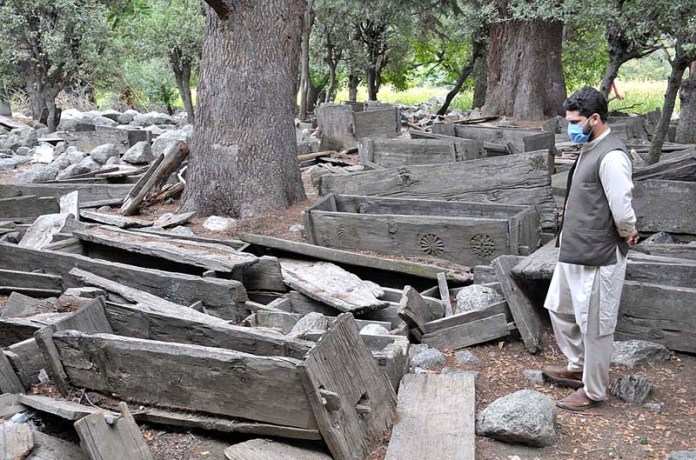 KALASH: September 14 – A view of graveyard of Kalash as the people of Kalash never buried their dead bodies they put them in a wooden box and left them under the open sky. Now they have started bury their dead bodies. APP photo by Saeed-ul-Mulk
