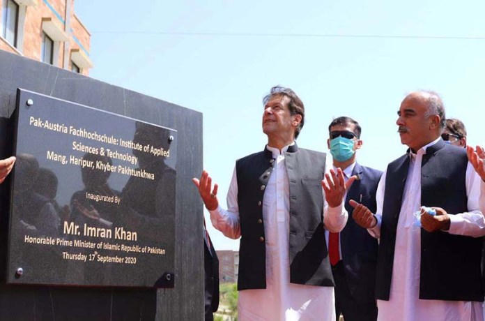 HARIPUR: September 17 – Prime Minister Imran Khan offering dua after unveiling the inaugural plaque of Pak-Austria Fachhochschule Institute of Applied Sciences & Technology in Mang. APP