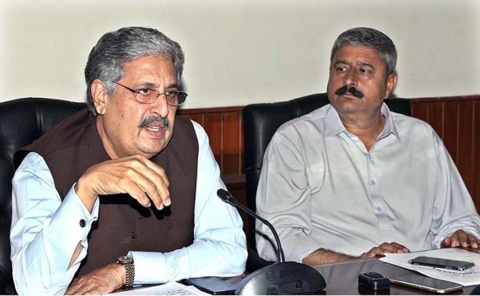 RAWALPINDI: September 09 - Chairman RDA Tariq Mahmood Murtaza and MD WASA Raja Shaukat addressing the media briefing at RDA Office. APP photo by Abid Zia